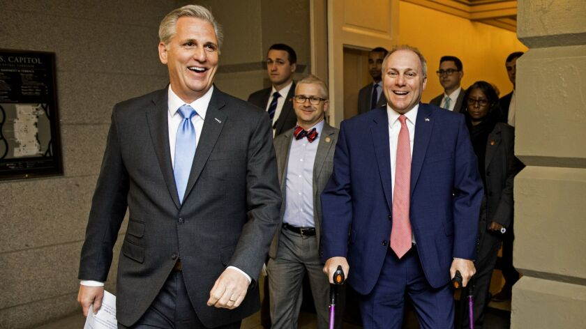 House Majority Leader Kevin McCarthy, left, Chief Deputy Whip Patrick T. McHenry (R-N.C.), front center, and Majority Whip Steve Scalise (R-La.), front right.
