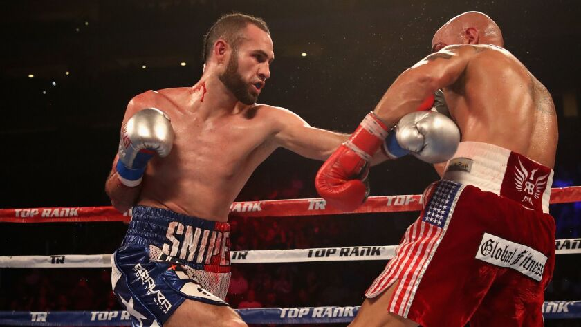 Jose Pedraza (L) of Puerto Rico fights Raymundo Beltran during the WBO lightweight championship bout at Gila River Arena in Glendale, Ariz,
