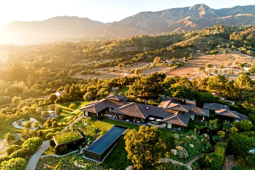 Set against a dramatic backdrop of mountains, the Bali-inspired estate features multiple houses and high-end amenities across nine acres.