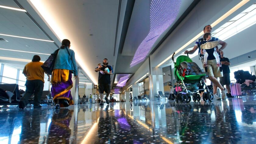 AUGUST 6, 2013. SAN DIEGO, CA. Art lighting and polished terrazo floors give passengers in the newl