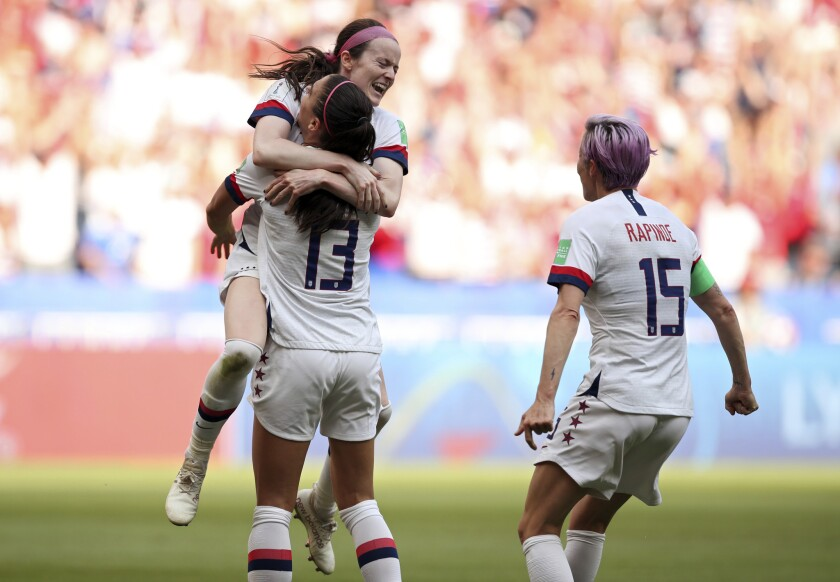 American midfielder Rose Lavelle leaps into the arms of Alex Morgan as they, along with Megan Rapinoe, celebrate a goal by Lavelle during the second half Sunday.