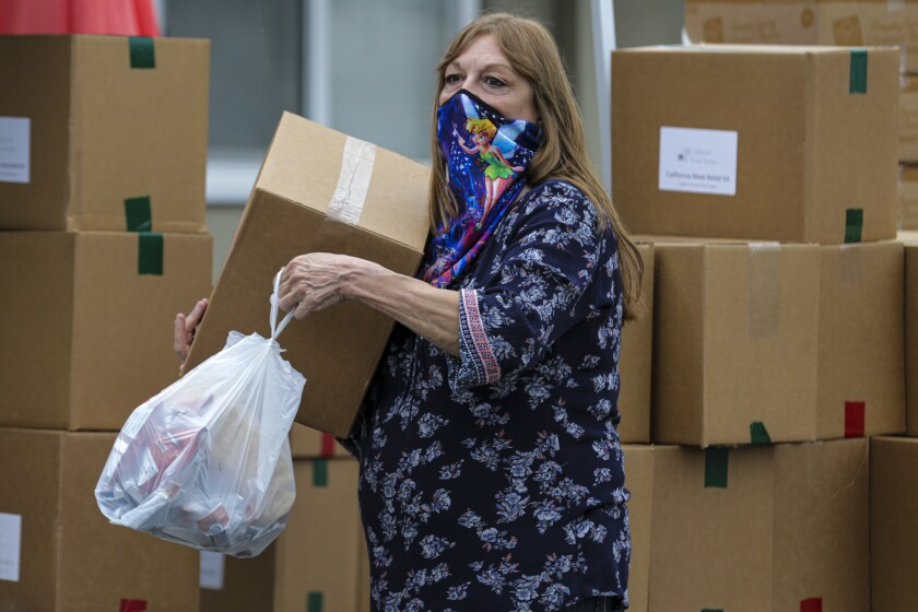 Tina Thomas volunteers at a food bank