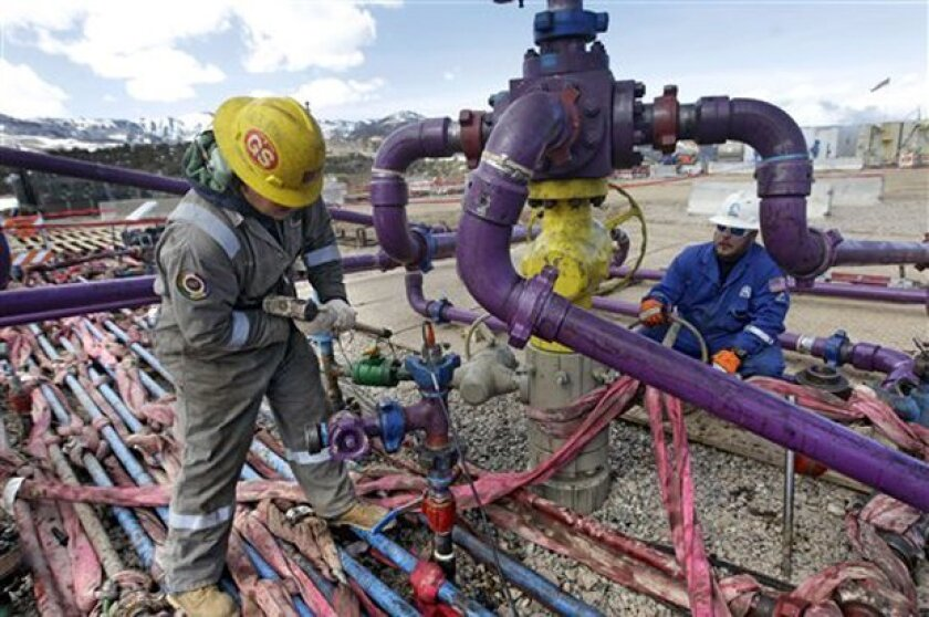 Workers tend to a well head during a hydraulic fracturing operation in western Colorado. Fracking came up in a recent debate between Democratic Party presidential candidates Bernie Sanders and Hillary Clinton.