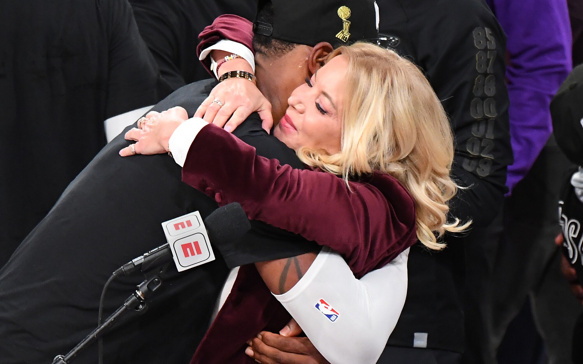 Lakers co-owner Jeanie Buss gets a hug from LeBron James after the team won the NBA championship.