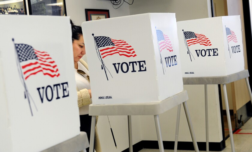 A voter makes selections at the L.A. County Registrar-Recorder's Office in Norwalk on Nov. 3.