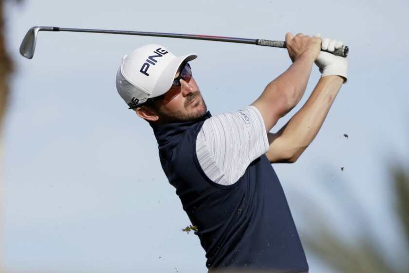 Andrew Landry hits from the eighth tee during the third round of The American Express golf tournament on Jan. 18, 2020.