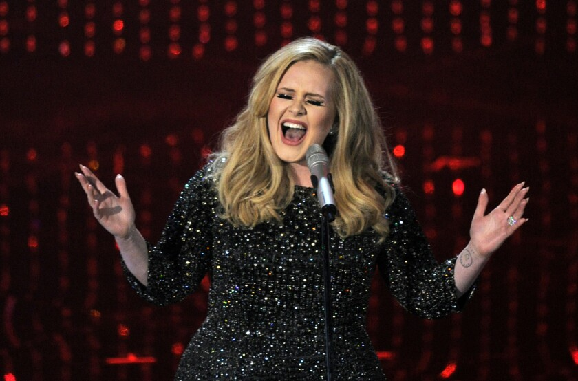 In this Feb. 24, 2013, file photo, Adele performs during the Oscars at the Dolby Theatre in Los Angeles.