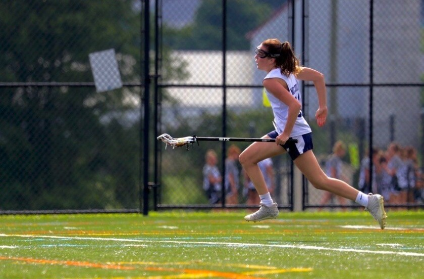 The Bishop's School student and lacrosse player Kate McCool in action.