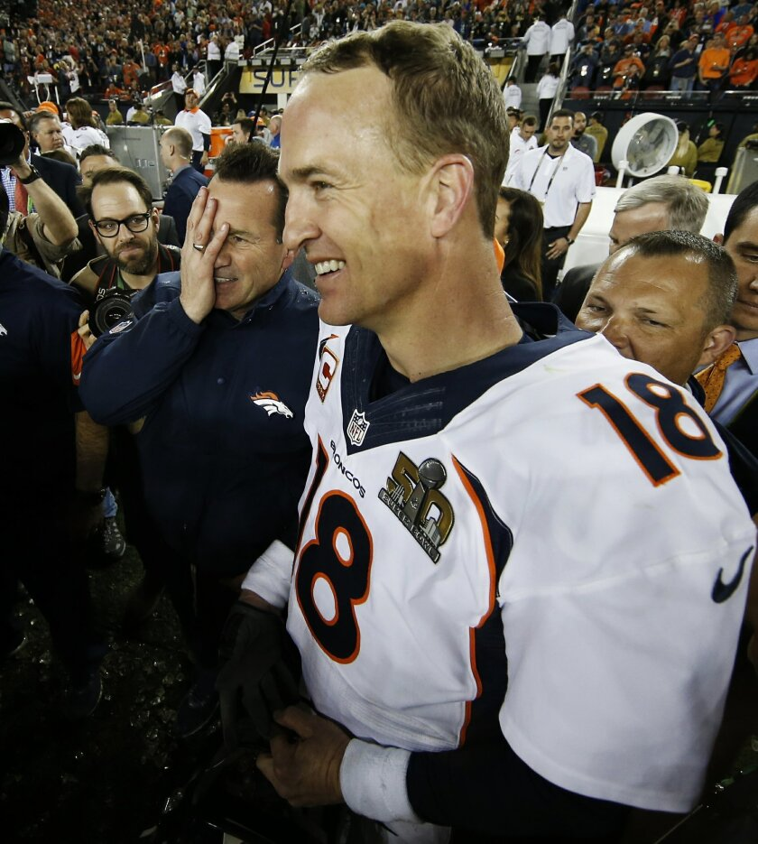 Denver Broncos' head coach Gary Kubiak, left, and Broncos' Peyton Manning (18) celebrate after winning the NFL Super Bowl 50 football game against the Carolina Panthers, Sunday, Feb. 7, 2016, in Santa Clara, Calif. The Broncos won 24-10.  (AP Photo/Matt Slocum)