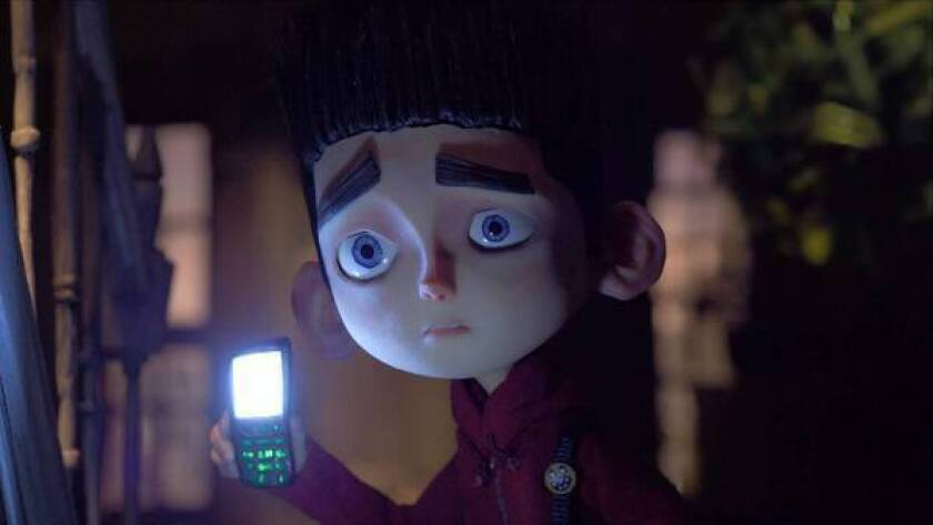 """Norman (voiced by Kodi Smit-McPhee) searches Mr. Prenderghast's house in """"ParaNorman."""""""
