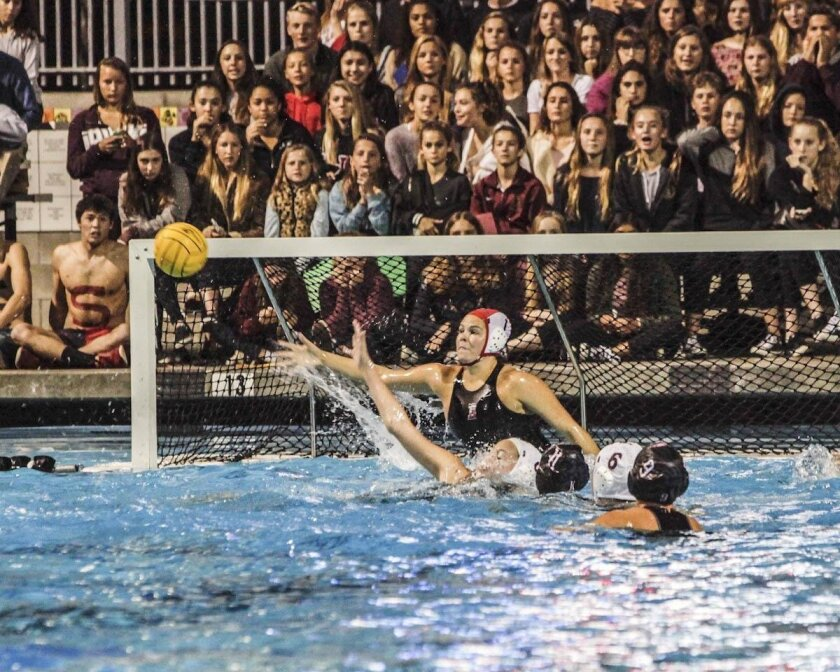 Bishop's goalie Cassidy Ball is instrumental to the Knights' defense, blocking shot after shot from the La Jolla High Vikings, during the CIF Championship (and cross-town rivalry) game Feb. 27 at Coggan Pool.    See story, A12