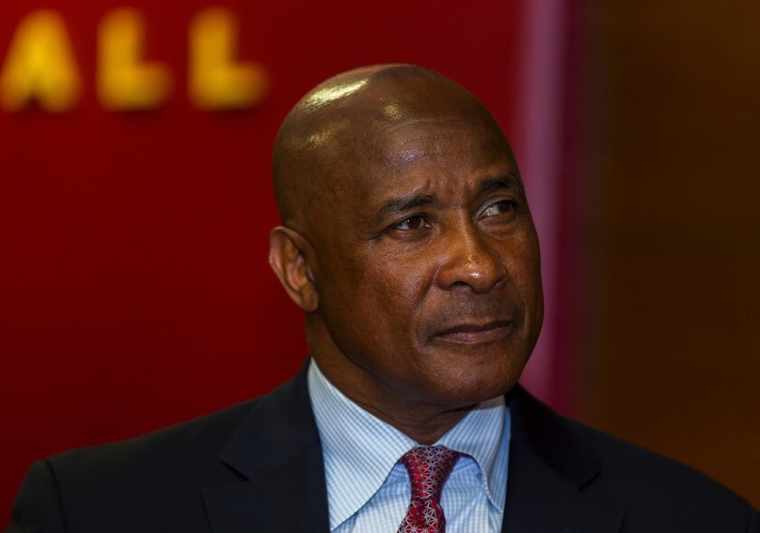 USC athletic director Lynn Swann pauses during a news conference at USC.