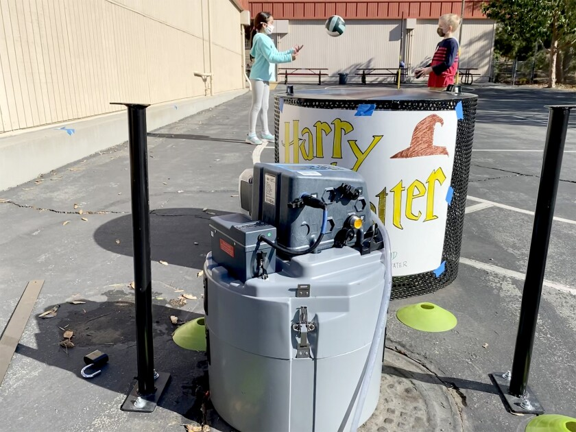 A robot at Vista Grande Elementary School tests wastewater for COVID-19.