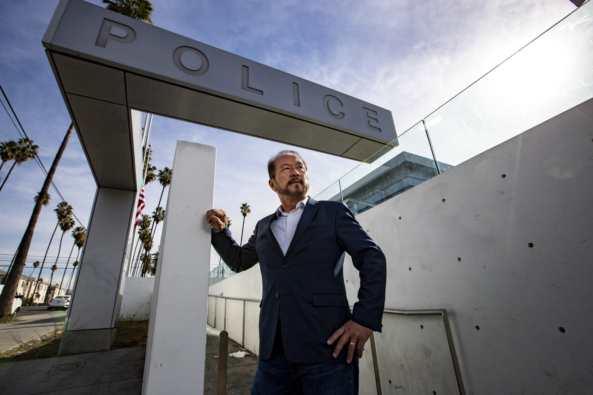 Chang Lee stands in front of the LAPD Olympic station.