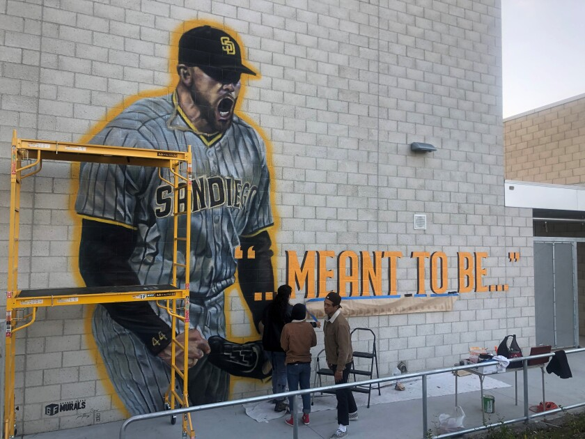 Artists commissioned by Padres work on mural at Grossmont High to honor Joe Musgrove for his no-hitter.