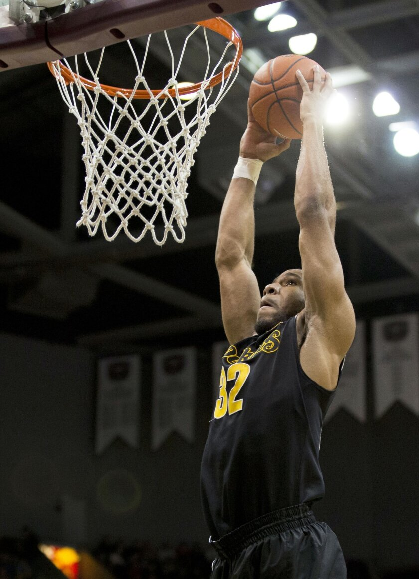 Wichita State guard Tekele Cotton (32) dunks the ball during the first half of an NCAA college basketball game against Missouri State on Saturday, Jan. 11, 2014, in Springfield, Mo. (AP Photo/David Welker)