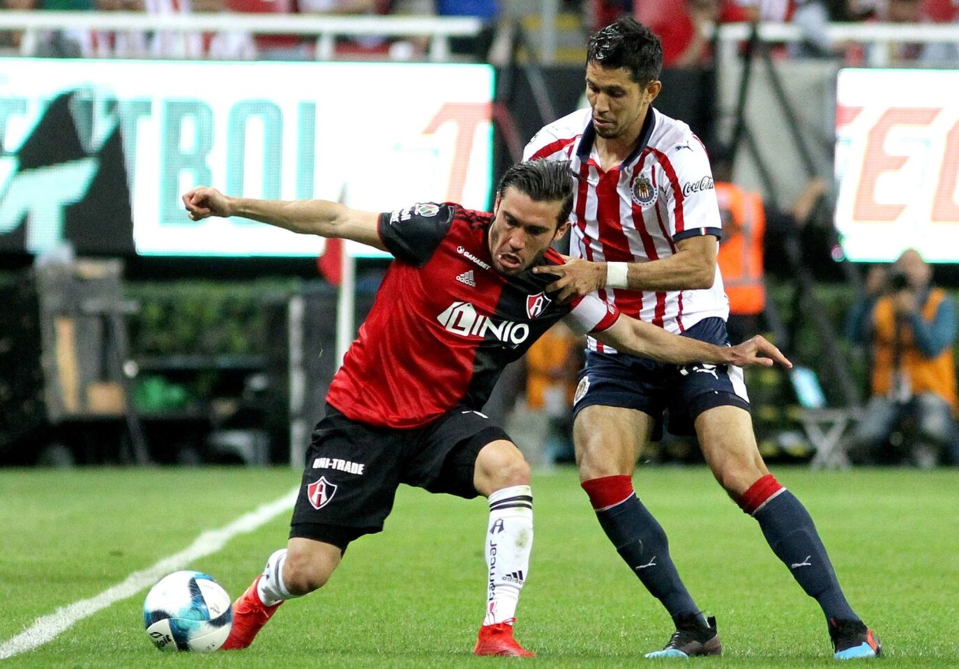 Jesus Molina (R) of Guadalajara vies for the ball with Juan Vigon (L) of Atlas during their Mexican Clausura 2019 tournament football match at Akron stadium in Guadalajara, Jalisco State, Mexico, on February 16, 2019. (Photo by Ulises Ruiz / AFP)ULISES RUIZ/AFP/Getty Images ** OUTS - ELSENT, FPG, CM - OUTS * NM, PH, VA if sourced by CT, LA or MoD **