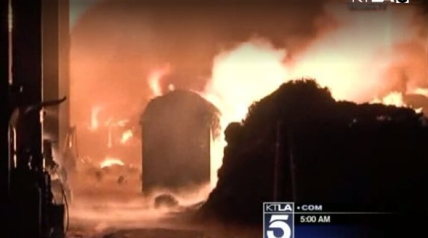 This screen shot from KTLA shows a massive fire that is burning in an industrial area in Los Angeles.