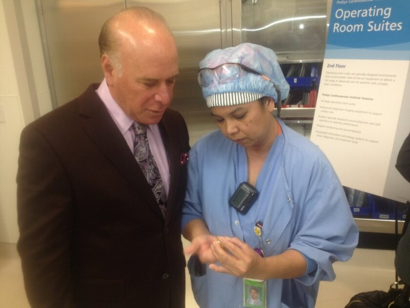 During a tour of the cardiac center, Maria Jarboe, a Scripps Health cardiothoracic nurse, shows La Jolla attorney Mark Krasner how a bovine heart valve is used to replace diseased heart valves in human patients. Studies show cow valves can last up to 25 years after a transplant.