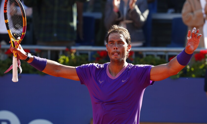 Rafael Nadal of Spain celebrates after defeating Cameron Norrie of Britain 6-1, 6-4 during a quarterfinal Godo tennis tournament in Barcelona, Spain, Friday, April 23, 2021. (AP Photo/Joan Monfort)
