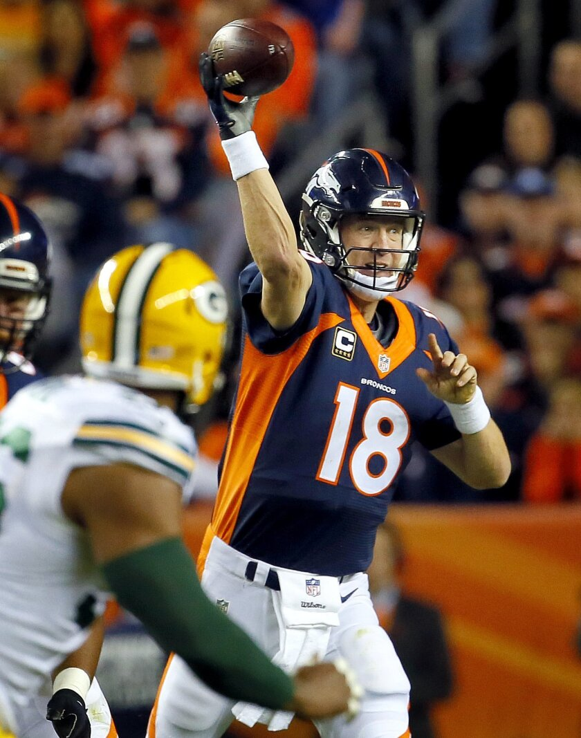 Denver Broncos quarterback Peyton Manning (18) passes against the Green Bay Packers during the first half of an NFL football game, Sunday, Nov. 1, 2015, in Denver. (AP Photo/Joe Mahoney)