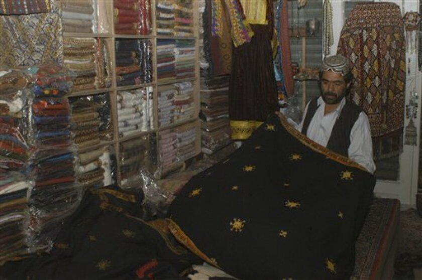 This image taken on Jan . 20, 2010 shows Ahmadullah Noorzai, 38, a shawl merchant in Quetta, Paksitan, saying that it is hard to recognize Taliban in Quetta. If Afghan Taliban fighters and their top leaders are roaming around this remote part of Pakistan as the U.S. alleges, the police chief here s