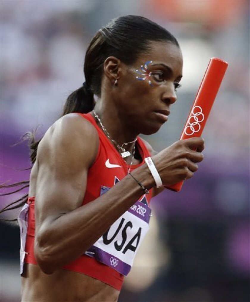 United States' Deedee Trotter competes in a women's 4x400-meter relay heat during the athletics in the Olympic Stadium at the 2012 Summer Olympics, London, Friday, Aug. 10, 2012. (AP Photo/Anja Niedringhaus)