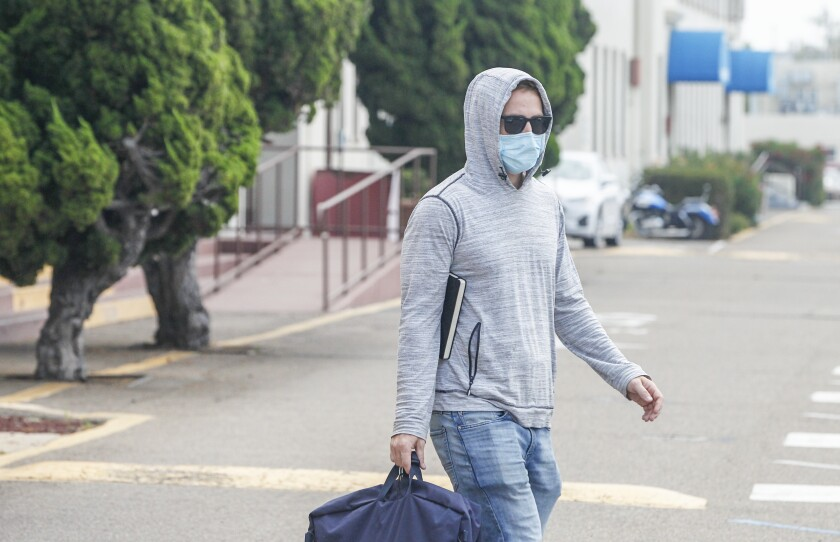 Navy SEAL Adel Enayat, accused of sexual assault, walks across a street after appearing for a hearing at Naval Base San Diego