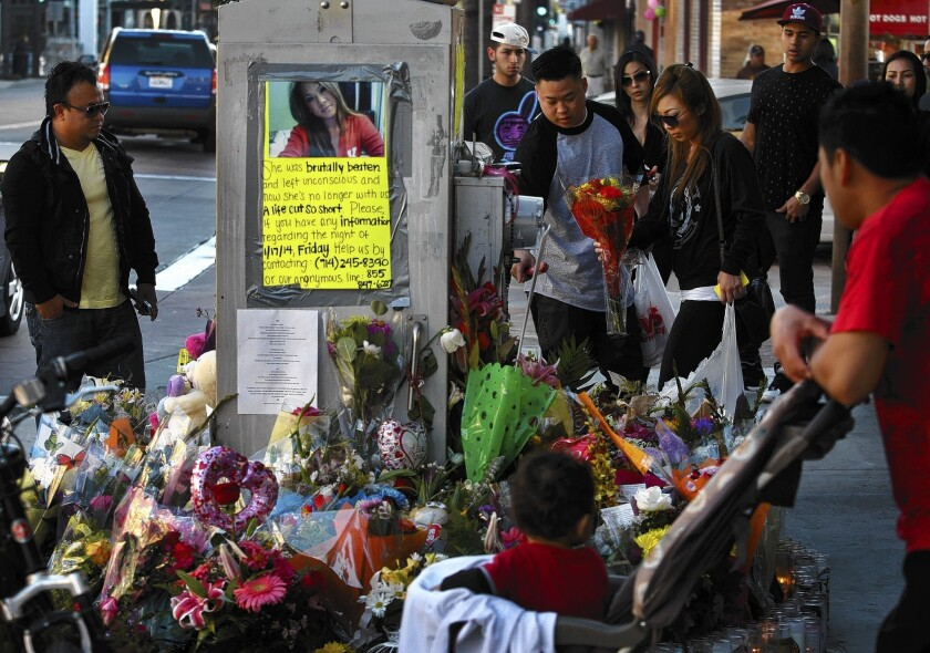 A memorial to Kim Pham near where she was killed. As Santa Ana police detectives try to make sense of the melee that led to her death, the investigation is running into a wall of silence.