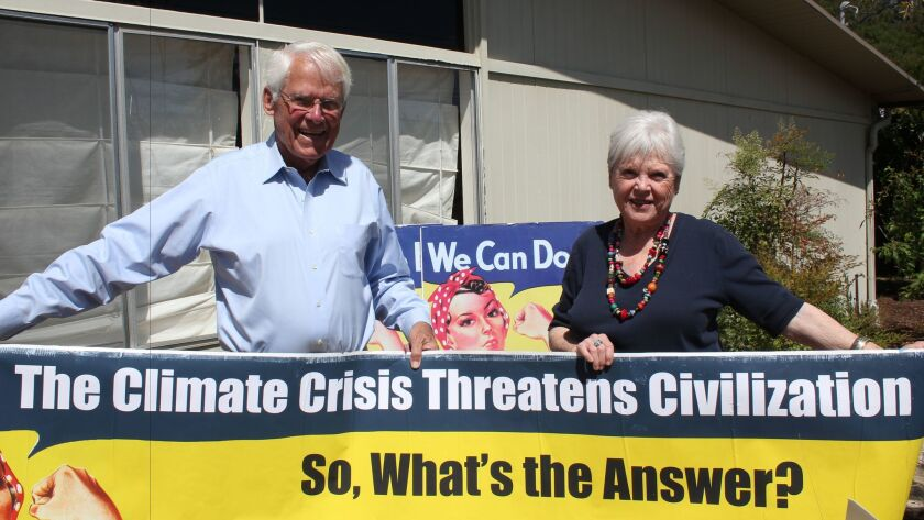 Derek and Nancy Casady with Rosie the Riveter, one of the iconic symbols adopted by the Climate Mobi