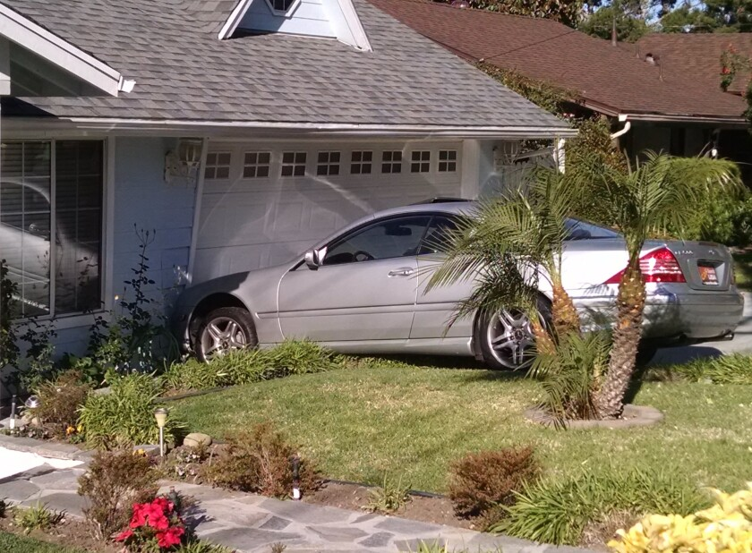 Street racer crashes into La Crescenta home