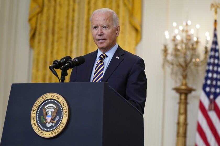 President Biden speaks at a podium at the White House