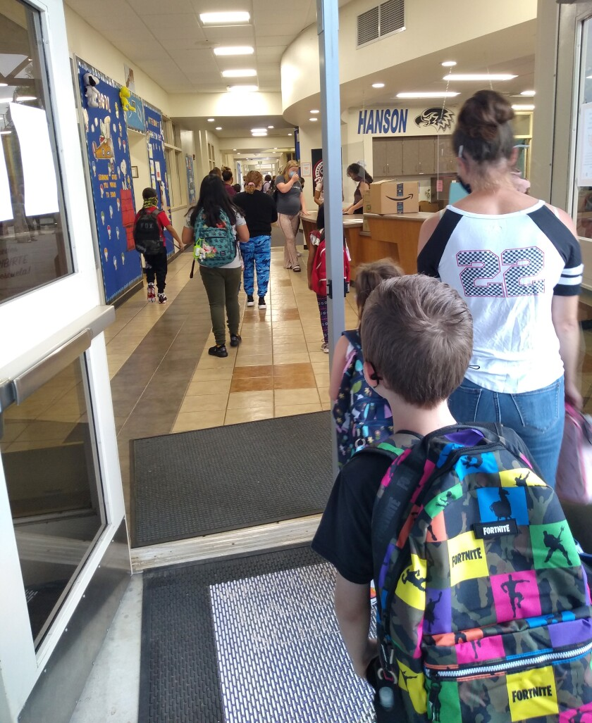 Teachers and administrators welcome students back at the start of a new school year at Hanson Elementary.