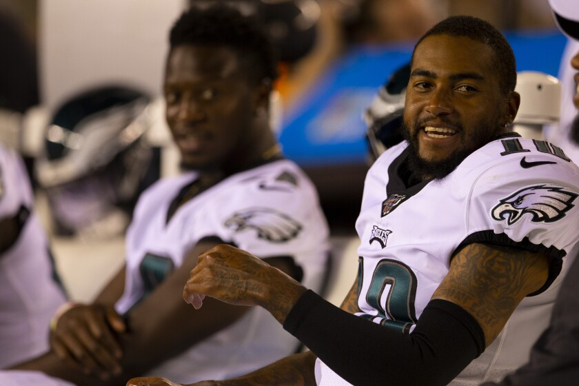 Philadelphia Eagles wide receiver DeSean Jackson laughs while sitting on the bench.