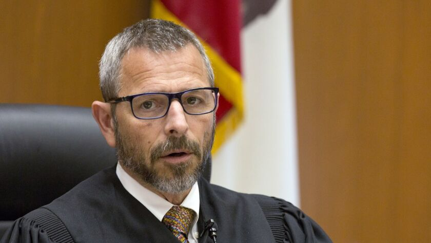 Los Angeles Superior Court Judge Gustavo N. Sztraicher reversed his order prohibiting journalists from describing the physical appearance of murder suspects seen in open court.