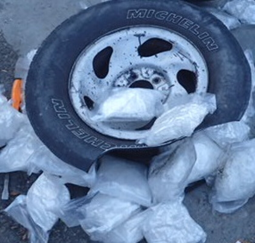Customs officers found bundles of meth and heroin in a van's spare tire and gas tank at the Otay Mesa Port of Entry.