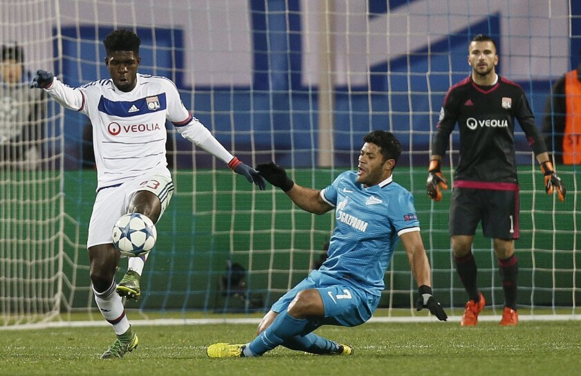 FILE - In this Tuesday, Oct. 20, 2015 file photo, Zenit's Hulk,right battles for the ball withL yon's Samuel Umtiti, during their UEFA Champions League, group H, soccer match, in St.Petersburg, Russia. Many nations are betting on youth at the European Championship, giving promising youngsters a cha