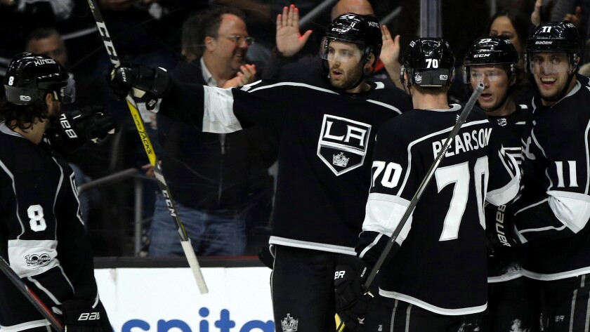 Kings center Tyler Toffoli (center) is congratulated by teammates after scoring against the Hurricans in the second period Saturday at Staples Center.