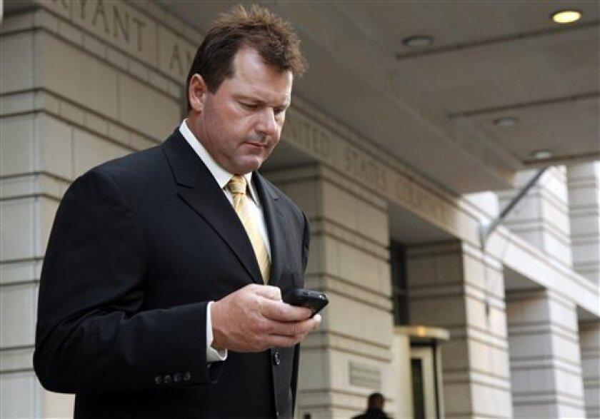 Former Major League Baseball pitcher Roger Clemens leaves federal court Monday, July 11, 2011, in Washington after a day of his trial on charges of lying to Congress in 2008 when he denied ever using performance-enhancing drugs. (AP Photo/Alex Brandon)