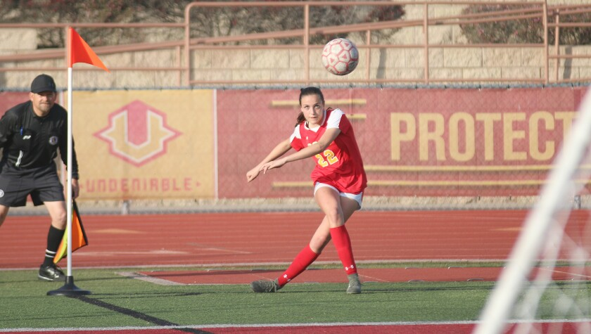 Junior Sophia Aragon launches a corner kick.