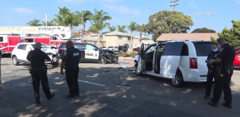 Chula Vista officers investigate a three-vehicle crash Wednesday afternoon involving a Police Department SUV on Fourth Avenue