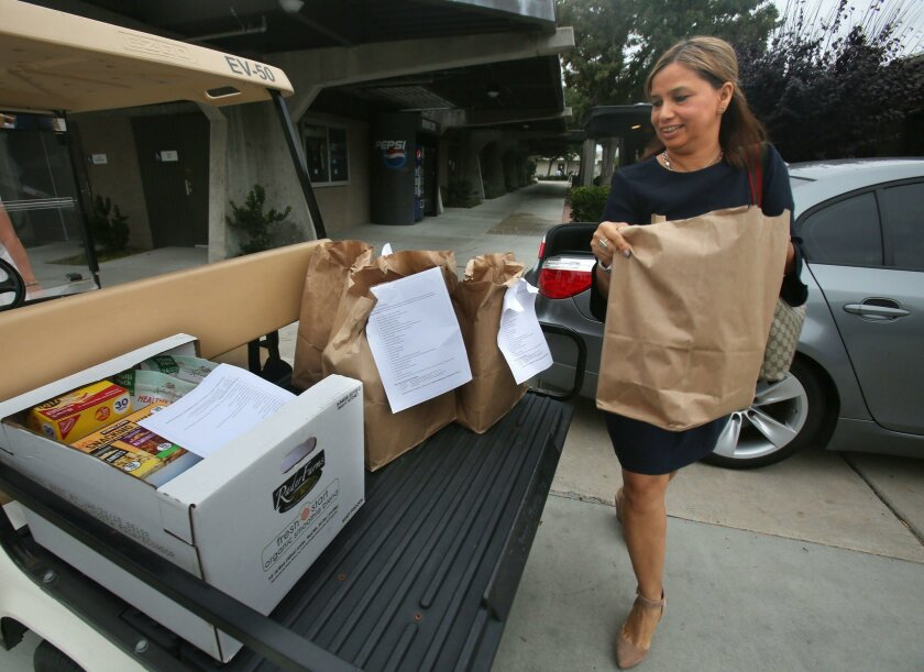 Patricia Bartow, who was instrumental in getting the pantry started, delivers donated food.