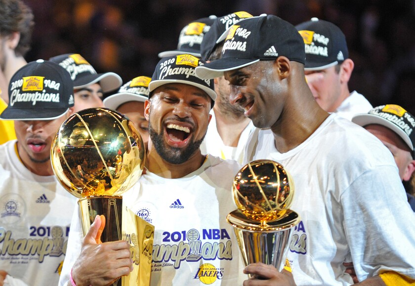 Lakers point guard Derek Fisher celebrates with teammate Kobe Bryant following the Lakers' Game 7 victory over the Boston Celtics in the 2010 NBA Finals.