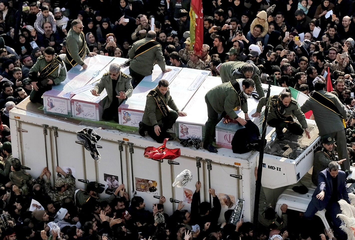 Coffins of Gen. Qassem Soleimani and others who were killed in Iraq by a U.S. drone strike, are carried on a truck surrounded by mourners during a funeral procession at the Enqelab-e-Eslami (Islamic Revolution) square in Tehran, Iran, Monday, Jan. 6, 2020. The processions mark the first time Iran honored a single man with a multi-city ceremony. Not even Ayatollah Ruhollah Khomeini, who founded the Islamic Republic, received such a processional with his death in 1989. Soleimani on Monday will lie in state at Tehran's famed Musalla mosque as the revolutionary leader did before him. (AP Photo/Ebrahim Noroozi)