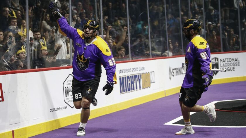 San Diego Seals forward Austin Staats (83) celebrates his first quarter goal against the Rochester Knighthawks with Kyle Buchanan (91).