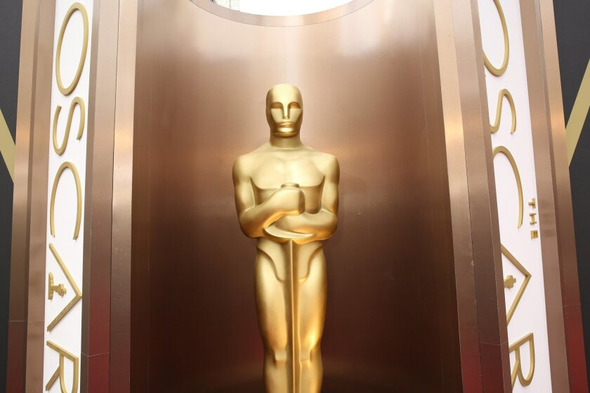 FILE - In this March 2, 2014 file photo, an Oscar statue is displayed at the Oscars at the Dolby Theatre in Los Angeles. Since the Academy of Motion Pictures Arts and Sciences said that it was altering membership rules in response to an outcry over the diversity of its voters and of its nominees, another uproar has erupted around Hollywood. Many academy members are protesting that the new measures unjustly scapegoat older academy members and imply they're racist. (Photo by Matt Sayles/Invision/AP, File)