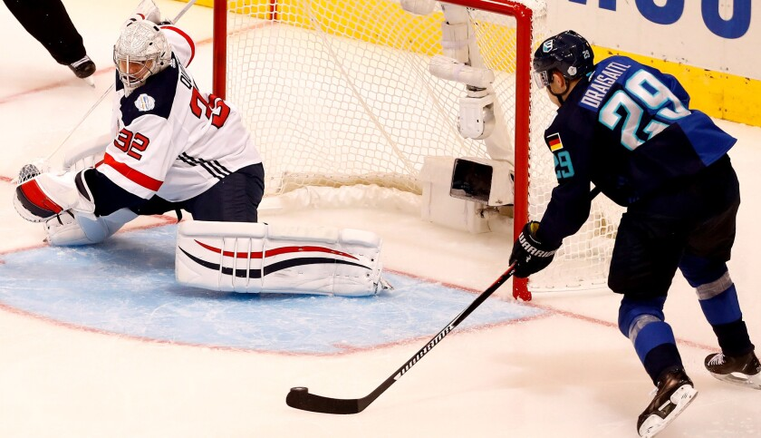 Team Europe's Leon Draisaitl takes a pass and is about to score on American goalkeeper Jonathan Quick in the second period Saturday.