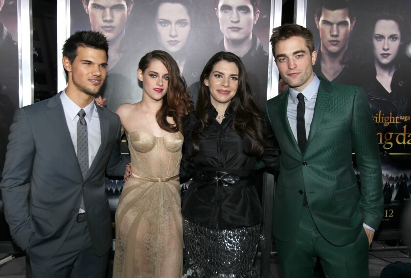 "Taylor Lautner, Kristen Stewart, author Stephenie Meyer and Robert Pattinson at a ""Twilight"" premiere."