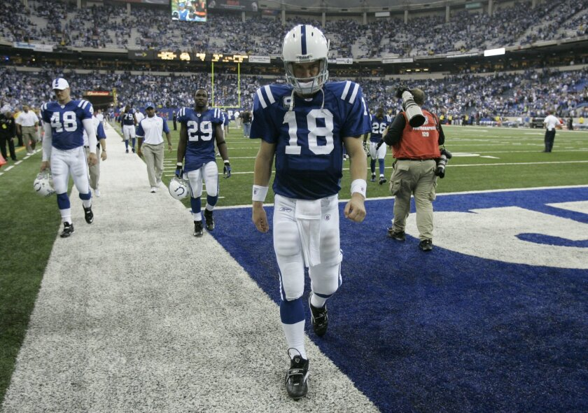 FILE - In this Nov. 4, 2007, file photo, Indianapolis Colts quarterback Peyton Manning (18) walks out of the field after the undefeated New England Patriots beat the undefeated Colts 24-20 in an NFL football game in Indianapolis.  The Broncos and Patriots are each 7-0 after the first weekend in Nov