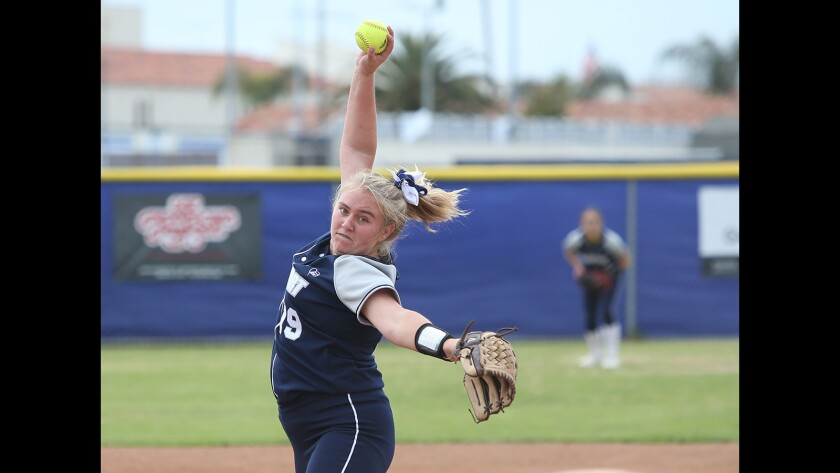 Newport pitcher Clare Austin makes a pitch early in the game during Battle of the Bay girls softball game against Corona del Mar on Tuesday.